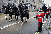 Mounted Met police officers ride on horseback before the funeral of Margaret Thatcher. Draped in the union flag and mounted on a gun carriage, the coffin of ex-British Prime Minister Baroness Margaret Thatcher's coffin travels along Fleet Street towards St Paul's Cathedral in London, England. Afforded a ceremonial funeral with military honours, not seen since the death of Winston Churchill in 1965, family and 2,000 VIP guests (incl Queen Elizabeth) await her cortege.