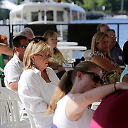 People listen to the sermon at The Anchor Sunday June 1, 2014 on the Wilmington, N.C. waterfront. (Jason A. Frizzelle)