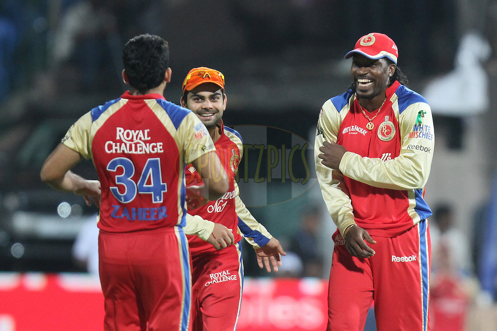 Chris Gayle (R), Virat Kohli (C) and Zaheer Khan of Royal Challengers Bangalore celebrate their win over Pune Warriors during match 35 of the the Indian Premier League ( IPL ) Season 4 between the Royal Challengers Bangalore and the Pune Warriors held at the Chinnaswamy Stadium, Bangalore, Karnataka, India on the 29th April 2011..Photo by Parth Sanyal/BCCI/SPORTZPICS