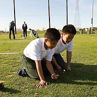 The First Tee of Monterey County opens the door to golf, as well as academic tutoring,  to many underprivileged kids of Salinas, CA, like Jose Calderon, left, who engages in a game of marbles on the golf range.