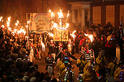 © Licensed to London News Pictures. 04/11/2017. Lewes, UK. People in costume carry burning torches as they take part in celebrations for the traditional Lewes Bonfire Night celebrations on Saturday, 4 November, 2017. Thousands of people attend the parade through the narrow streets of Lewes and burn effigies to celebrate Guy Fawkes nightalso known as bonfire night, the anniversary of the gunpowder plot to blow up the Houses of Parliament in London. Photo credit: London News pictures