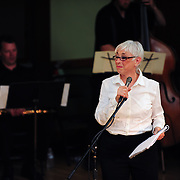 Brenda Bufalino at the Mic with saxophonist Matt Langley and Bassist Nathan Therrien in the background.