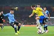 Uruguay midfielder Lucas Torreira (14) and Brazil defender Filipe Luis (6) during the Friendly International match between Brazil and Uruguay at the Emirates Stadium, London, England on 16 November 2018.