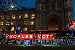 "© Licensed to London News Pictures. 11/12/2018. LONDON, UK. Signs showing the words ""Peoples Vote"" are held up outside the House of Commons by anti-Brexit demonstrators from SODEM (Stand Of Defiance European Movement). Theresa May, Prime Minister, is touring European capitals to try to renegotiate the Brexit agreement with the European Union after today's meaningful vote by MP's was deferred.  Photo credit: Stephen Chung/LNP"