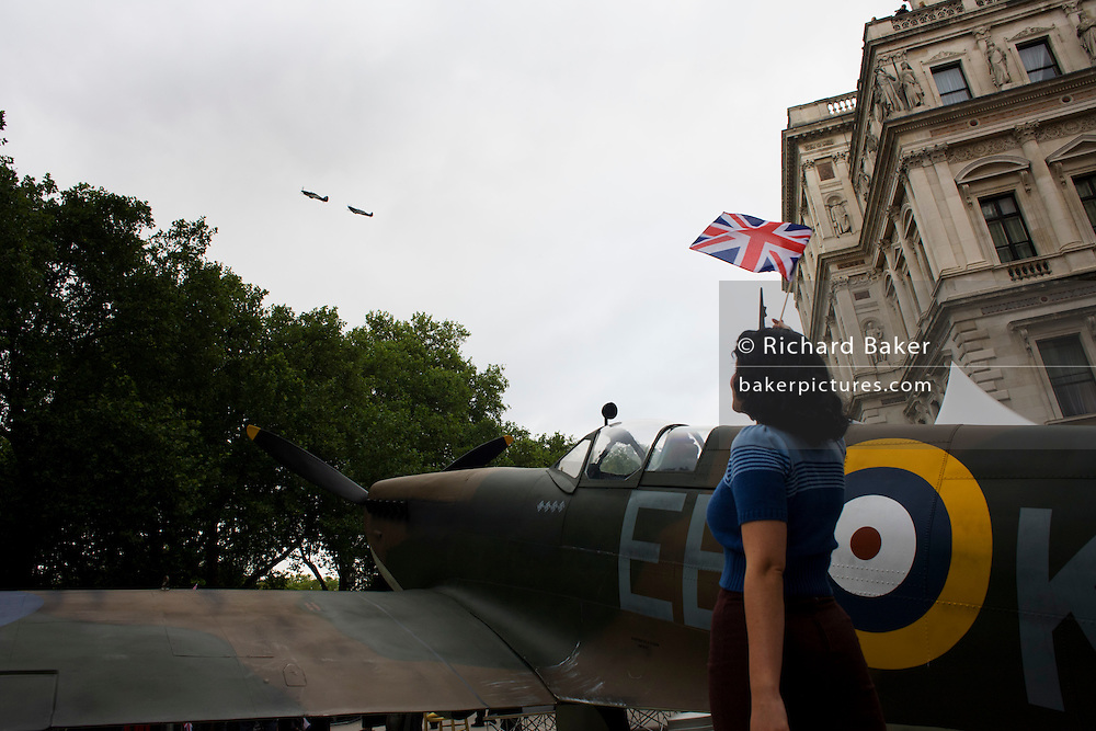 Flypast by two Spitfires over replica and waving 40s lady at the 70th anniversary of WW2 Battle of Britain.