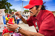 "10 JANUARY 2007 - MANAGUA, NICARAGUA: A vender sells raspados (fruit flavored iced treats) to Sandanista supporters arriving in Managua to participate in the inauguration of Daniel Ortega Wednesday. Ortega, the leader of the Sandanista Front, was sworn in as the President of Nicaragua Wednesday. Ortega and the Sandanistas ruled Nicaragua from their victory of ""Tacho"" Somoza in 1979 until their defeat by Violetta Chamorro in the 1990 election.  Photo by Jack Kurtz"