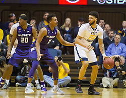 Feb 11, 2017; Morgantown, WV, USA; West Virginia Mountaineers forward Esa Ahmad (23) dribbles the ball and is guarded by Kansas State Wildcats guard Brian Patrick (11) during the first half at WVU Coliseum. Mandatory Credit: Ben Queen-USA TODAY Sports