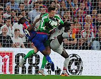Football - 2018 / 2019 Premier League - Crystal Palace vs. Liverpool<br /> <br /> Crystal Palace goalkeeper, Wayne Hennessey and Aaron Wan - Bissaka combine to foil Sadio Mane, at Selhurst Park.<br /> <br /> COLORSPORT/ANDREW COWIE
