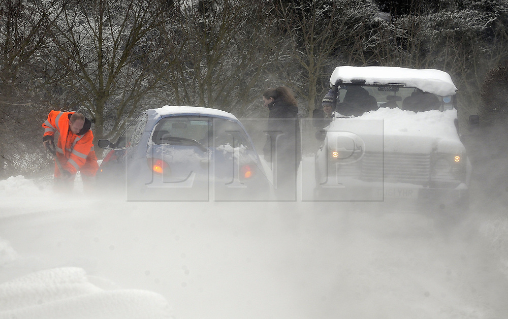 © Licensed to London News Pictures. 12/03/2013.Snow and high winds in Kent over night and this morning (12.03.2013). Heavy snow in Otford, Sevenoaks,Kent as a female drive gets her car stuck in the snow and blizzards in Pilgrims Way West..Photo credit : Grant Falvey/LNP