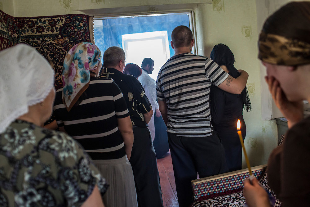 STAROVAVAROVKA, UKRAINE - MAY 16:  Mourners attend the funeral of Elena Ott, 42, on May 16, 2014 in Starovavarovka, Ukraine. Ott was killed two days prior when the car she was riding in was fired on by forces her family believes to be the Ukrainian military. (Photo by Brendan Hoffman/Getty Images) *** Local Caption ***