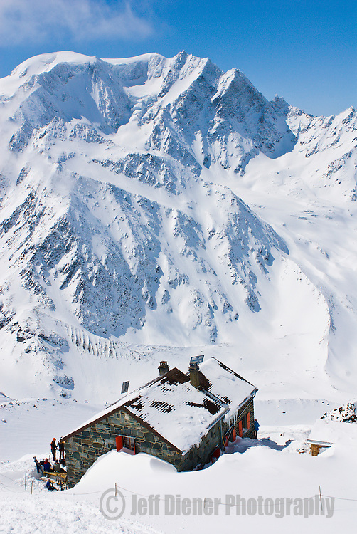 The Valsorey Hut overlooks grand views of Mont Velan in the Swiss Alps.