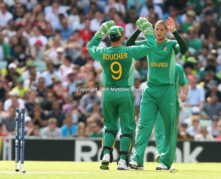Wayne Parnell of South Africa celebrates taking the wicket of Jerome Taylor of the West Indies with Mark Boucher. West Indies v South Africa, World T20, Cricket, The Oval, 13/06/2009 © Matthew Impey/Wiredphotos.co.uk. tel: 07789 130 347 email: matt@wiredphotos.co.uk