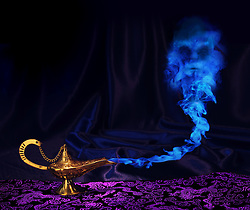 maagic Aladdin genie lamp with genie arising from blue smoke