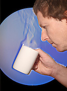 A schlieren image of a man drinking hot coffee.  The schlieren images identifies areas of different temperature by using the change in the index of refraction of a fluid due to a change in temperature.