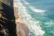 Aerial photograph of 4 wheel drive trucks driving on the beach, Great Sandy National Park, Sunshine Coast, Queensland, Australia