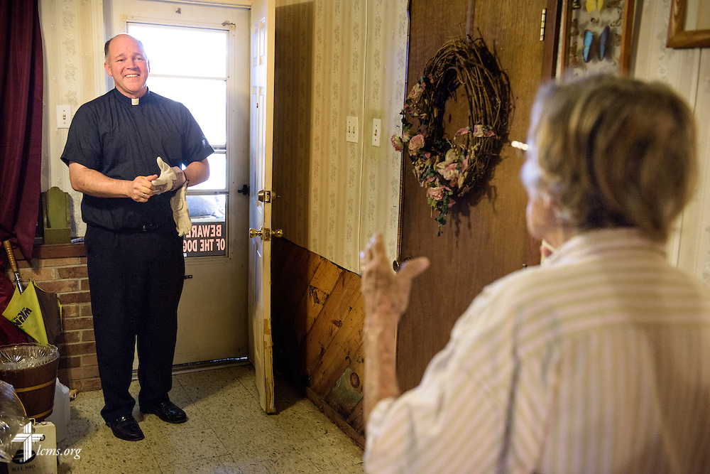 The Rev. David Buss, senior pastor of Trinity Lutheran Church, Baton Rouge, La., visits church charter member Althea Neptune in her flood-damaged home on Wednesday, Sept. 14, 2016, in Baton Rouge. LCMS Communications/Erik M. Lunsford