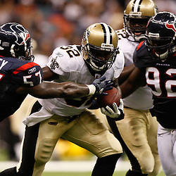 August 21, 2010; New Orleans, LA, USA; New Orleans Saints running back P.J. Hill (32) breaks the tackle of Houston Texans linebacker Kevin Bentley (57) during the second half of a 38-20 win by the New Orleans Saints over the Houston Texans during a preseason game at the Louisiana Superdome. Mandatory Credit: Derick E. Hingle
