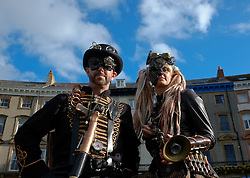 © Licensed to London News Pictures. <br /> 01/11/2014. <br /> <br /> Whitby, Yorkshire, United Kingdom<br /> <br /> Gez and Krista Long from Leeds attend the 20th anniversary of the Whitby Goth Weekend dressed as Steampunks.<br /> <br /> The event this weekend brings together thousands of extravagantly dressed followers of Victoriana, Steampunk, Cybergoth and Romanticism who all visit the town to take part in celebrating Gothic culture. This weekend marks the 20th anniversary since the event was started by local woman Jo Hampshire.<br /> <br /> Photo credit : Ian Forsyth/LNP