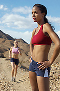 Two female joggers in mountains