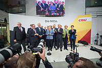 24 SEP 2017, BERLIN/GERMANY:<br /> Angela Merkel (M), CDU, Bundeskanzlerin, tritt ein zweites mal ans Mikrofon, eingerahmt von Karl-Josef Laumann, Philipp Murmann, Armin Laschet, Joachim Herrmann, Volker Kauder, Klaus Schueler, Thomas de Maiziere, David McAllister, Peter Tauber, Jens Spahn, Thomas Strobl, Elmar Brok, Monika Gruetters, Annegret Kramp-Karrenbauer, (v.L.n.R.), Wahlparty in der Wahlnacht, Bundestagswahl 2017, Konrad-Adenauer-Haus, CDU Bundesgeschaeftsstelle<br /> IMAGE: 20170924-01-075<br /> KEYWORDS: Election Party, Election Night