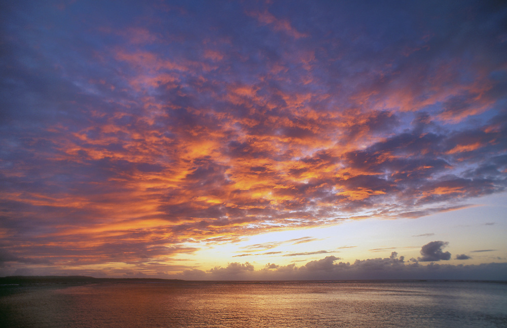 Saipan, Northern Marianas Islands, Micronesia: sunset from Pacific Islands Club resort with Tinian Island on the horizon.