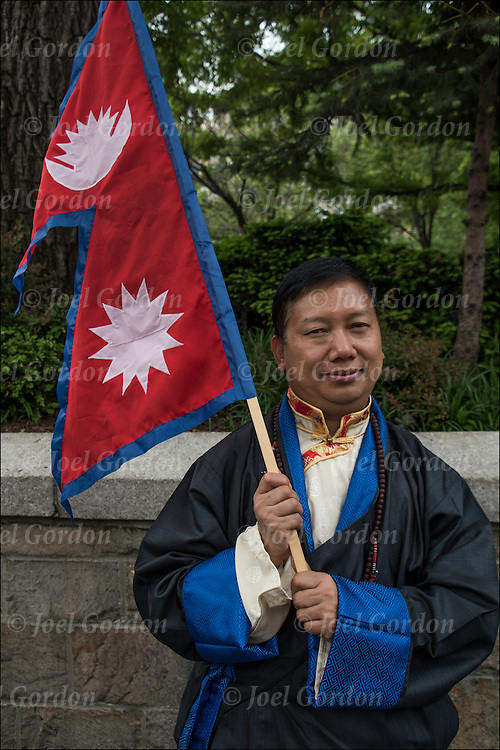 Portrait of Nepalese male holding Nepal flag after the Nepal Day Parade in Union Square Park.<br /> <br /> Nepal is a landlocked country in South Asia and occupies an area of 56,136 square miles. Located between China and India, Nepal is known for its majestic Himalayas and is the home of Mount Everest, the highest peak in the world. Nepal is also the birthplace of Lord Buddha. The national capital is Kathmandu.