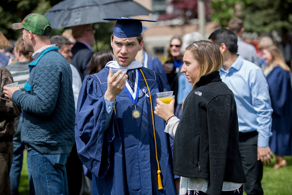 Families and friends celebrate the class of 2017's graduation with a champagne social on Herak Quad following commencement on May 14. Photo by Libby Kamrowski