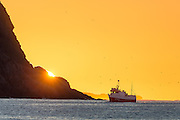 Fishing boat in sunset at the west coast of Norway   Fiskebåten Linebas SF-19-B i solnedgang ved Kvalsvik i Herøy.