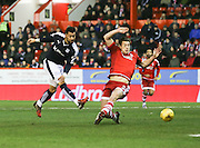Aberdeen&rsquo;s Ash Taylor can't stop Dundee&rsquo;s Kane Hemmings getting a shot on goal  - Aberdeen v Dundee, Ladbrokes Premiership at Pittodrie<br /> <br />  - &copy; David Young - www.davidyoungphoto.co.uk - email: davidyoungphoto@gmail.com
