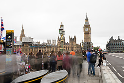© Licensed to London News Pictures. 21/08/2017. LONDON, UK.  People gather on Westminster Bridge as Big Ben's bongs ring out for the final time before repairs are undertaken and the chimes of the clock stopped for health and safety reasons.  Photo credit: Vickie Flores/LNP