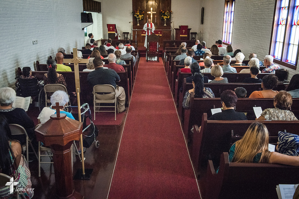 The Rev. Mark Barz, third vice president of the Texas District and pastor of Crown of Life Lutheran Church, San Antonio, Texas, leads the installation service for the Rev. Dr. Antonio Lopez (seated), new national missionary pastor at El Calvario Lutheran Church on Sunday, July 31, 2016, at the parish in Brownsville, Texas. LCMS Communications/Erik M. Lunsford