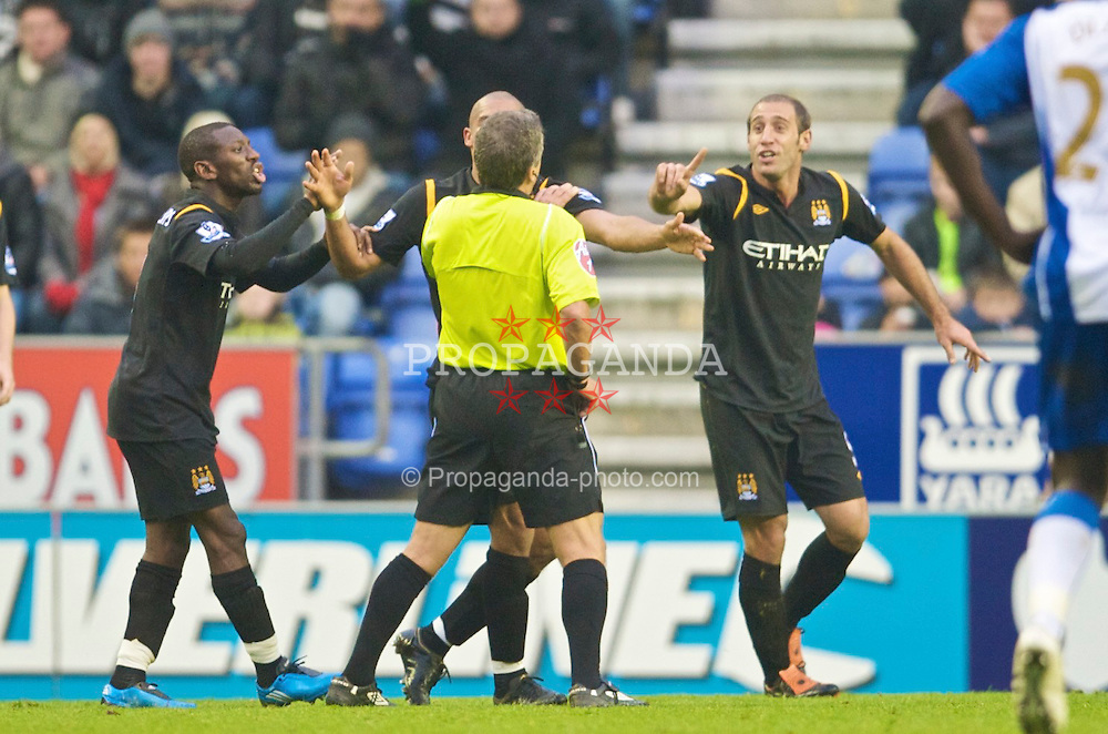 WIGAN, ENGLAND - Sunday, October 18, 2009: Manchester City's Pablo Zabaleta protests his innocence before referee Alan Ailey shows him a second yellow, followed by a red card during the Premiership match against Wigan Athletic at the JJB Stadium. (Pic by David Rawcliffe/Propaganda)