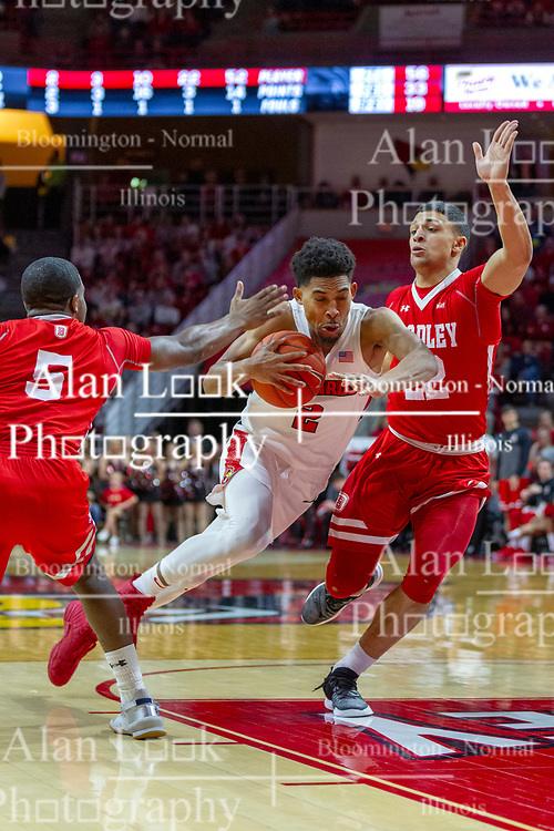 NORMAL, IL - February 16: Zach Copeland storms the paint defended and double teamed by Darrell Brown and Ja'Shon Henry during a college basketball game between the ISU Redbirds and the Bradley Braves on February 16 2019 at Redbird Arena in Normal, IL. (Photo by Alan Look)
