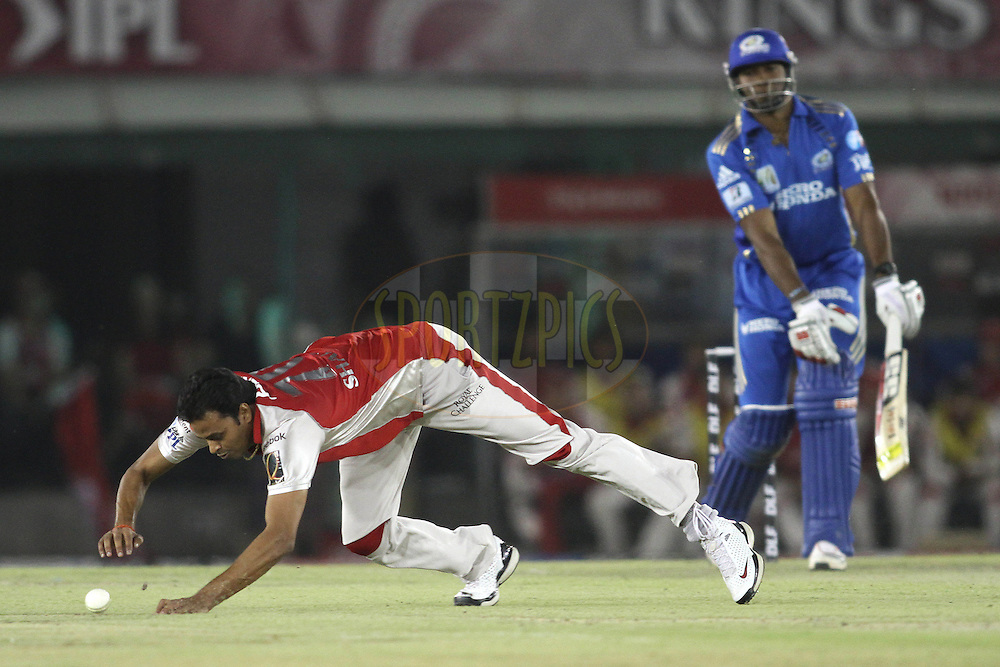 Shalabh Srivastava of the Kings XI Punjab attempts to make a diving stop during match 54 of the Indian Premier League ( IPL ) Season 4 between the Kings XI Punjab and the Mumbai Indians held at the PCA stadium in Mohali, Chandigarh, India on the 10th May 2011..Photo by Shaun Roy/BCCI/SPORTZPICS .