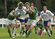 © Peter Spurrier / Intersport images.email images@intersport-images.com.29/6/03 Photo Peter Spurrier.IRB U21 Rugby World Cup - Henley - Oxon.Ireland v Italy.No.8  Antonio Ravanello breaking through the Irish defence.