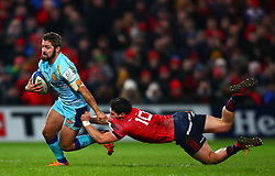 Tom O'Flaherty of Exeter Chiefs bypasses Joey Carbery of Munster Rugby - Mandatory by-line: Ken Sutton/JMP - 19/01/2019 - RUGBY - Thomond Park - Limerick,  - Munster Rugby v Exeter Chiefs -