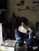 Teenager Sitting In Garage