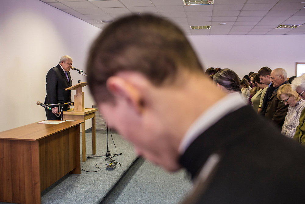 LUHANSK, UKRAINE - MARCH 15, 2015: Members of a Jehovah's Witnesses congregation attend church in Luhansk, Ukraine. CREDIT: Brendan Hoffman for The New York Times