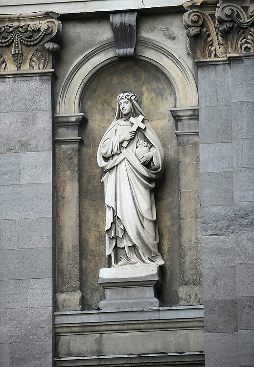 A statue on the side of a The Cathedral of the Most Holy Trinity in Waterford, Ireland.