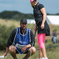 Picture by Christian Cooksey/CookseyPix.com . Standard repro rates apply. <br /> <br /> Aberdeen Asset Management Ladies Scottish Open at Dundonald Links, Irvine Ayrshire. <br /> <br /> Scotland's  Carly Booth and her caddy discuss line up a putt on the tenth green.