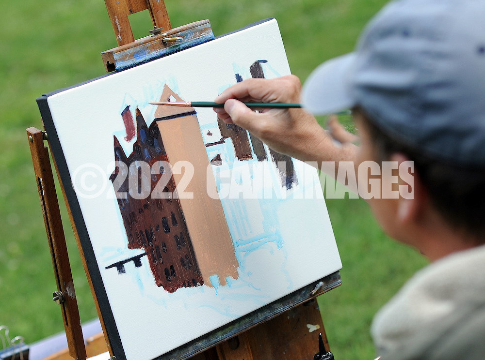 "Artist John Schmidtberger paints a picture during the first ever Bucks County Plein Air Festival Wednesday June 8, 2016 at the Mercer Museum in Doylestown, Pennsylvania.  The competitively-selected artists will paint outdoors ""en plein air"" or ""in open air"" over the course of three days in various locations throughout the county to create various landscapes and streetscapes. (Photo by William Thomas Cain)"