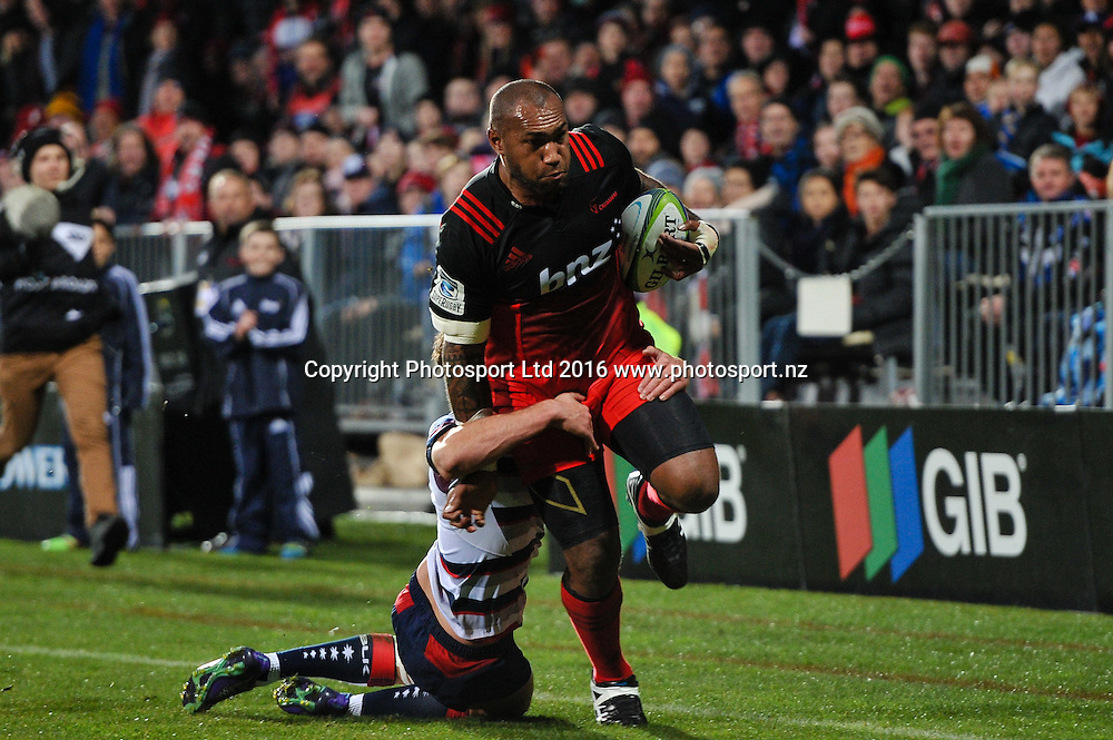 Nemani Nadolo of the Crusaders is tackled by  a Rebel player during the Super Rugby Match, Crusaders V Rebels, AMI Stadium, Christchurch, New Zealand. 9th July 2016. Copyright Photo: John Davidson / www.photosport.nz