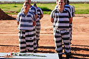 "18 MARCH 2010 - SURPRISE, AZ:  Members of the Maricopa County Sheriff's Dept ""Chain Gang"" work to bury people in White Tanks Cemetery on Camelback Rd. in an unincorporated part of the county near Surprise. The county spent about $2.5 million to inter indigent people in what is Maricopa County's ""potters field."" About 3,000 people, children and adults, are buried in the dusty field west of Phoenix.     PHOTO BY JACK KURTZ"