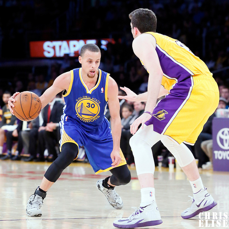 11 April 2014: Golden State Warriors guard Stephen Curry (30) dribbles during the Golden State Warriors 112-95 victory over the Los Angeles Lakers at the Staples Center, Los Angeles, California, USA.