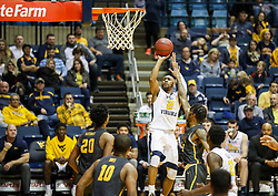 Dec 20, 2017; Morgantown, WV, USA; West Virginia Mountaineers guard Jevon Carter (2) shoots a jumper during the second half against the Coppin State Eagles at WVU Coliseum. Mandatory Credit: Ben Queen-USA TODAY Sports