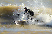 Surfing on Lake Michigan near Sheboygan, Wisconsin on October 27, 2010.   Photo by Mike Roemer / Mike Roemer Photography Inc. 920-217-8021