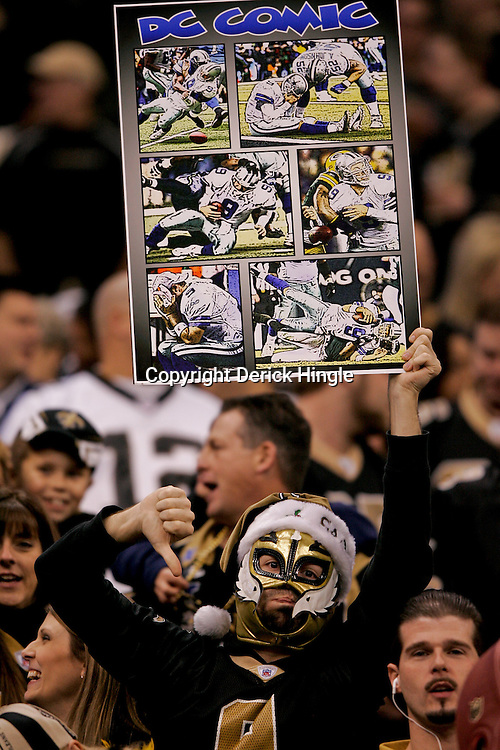 2009 December 19:  A New Orleans Saints fan holds up a sign during a 24-17 win by the Dallas Cowboys over the New Orleans Saints at the Louisiana Superdome in New Orleans, Louisiana.