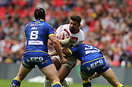 Mickael Simon of Catalans Dragons on the attack against Chris Hill and Ben Westwood of Warrington Wolves during the Ladbrokes Challenge Cup Final match at Wembley Stadium, London<br /> Picture by Stephen Gaunt/Focus Images Ltd +447904 833202<br /> 25/08/2018
