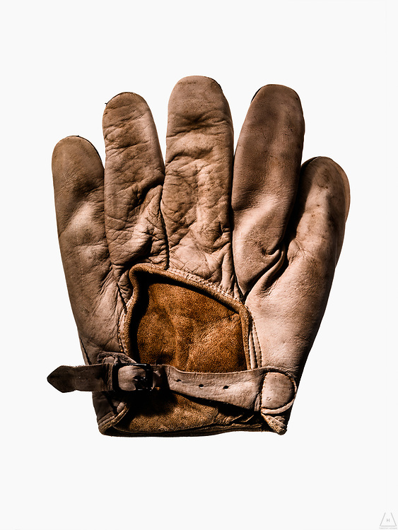 "An isolated shot of a rare ""Fingertip"" Workman baseball glove circa 1880 with detail and texture"