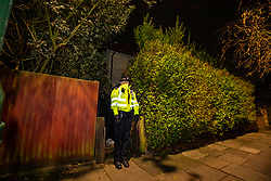 © Licensed to London News Pictures. 03/01/2020. London, UK. A police officer stands outside a house in Nowell Road, Barnes South London. A police investigation is underway after human remains are found at the address. Photo credit: Alex Lentati/LNP